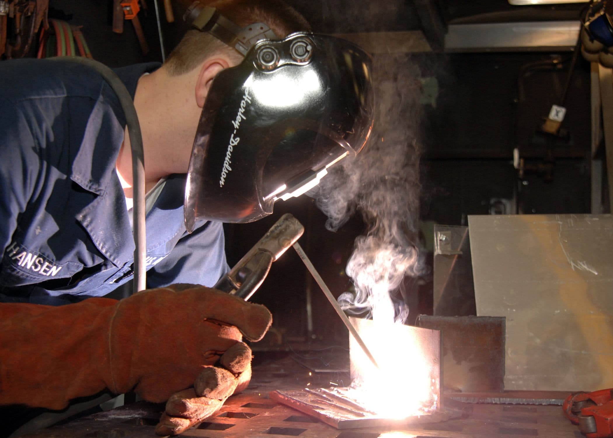 "<img src=""welding.jpg"" alt=""Man laying beads"">"