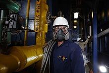 a man wearing a welding respirator