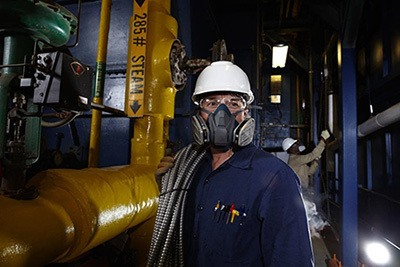 a man wearing a welding respirator
