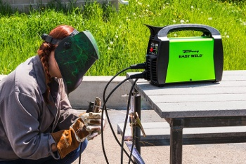 a stick welder on a table