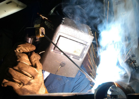man wearing welding helmet