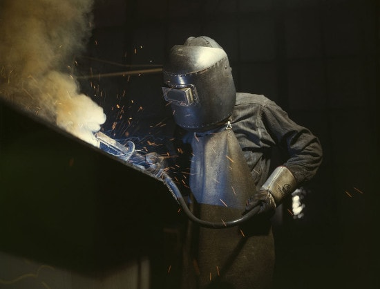 man working on metal welding