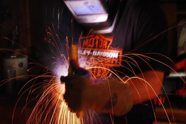A welder using a symbol blueprint