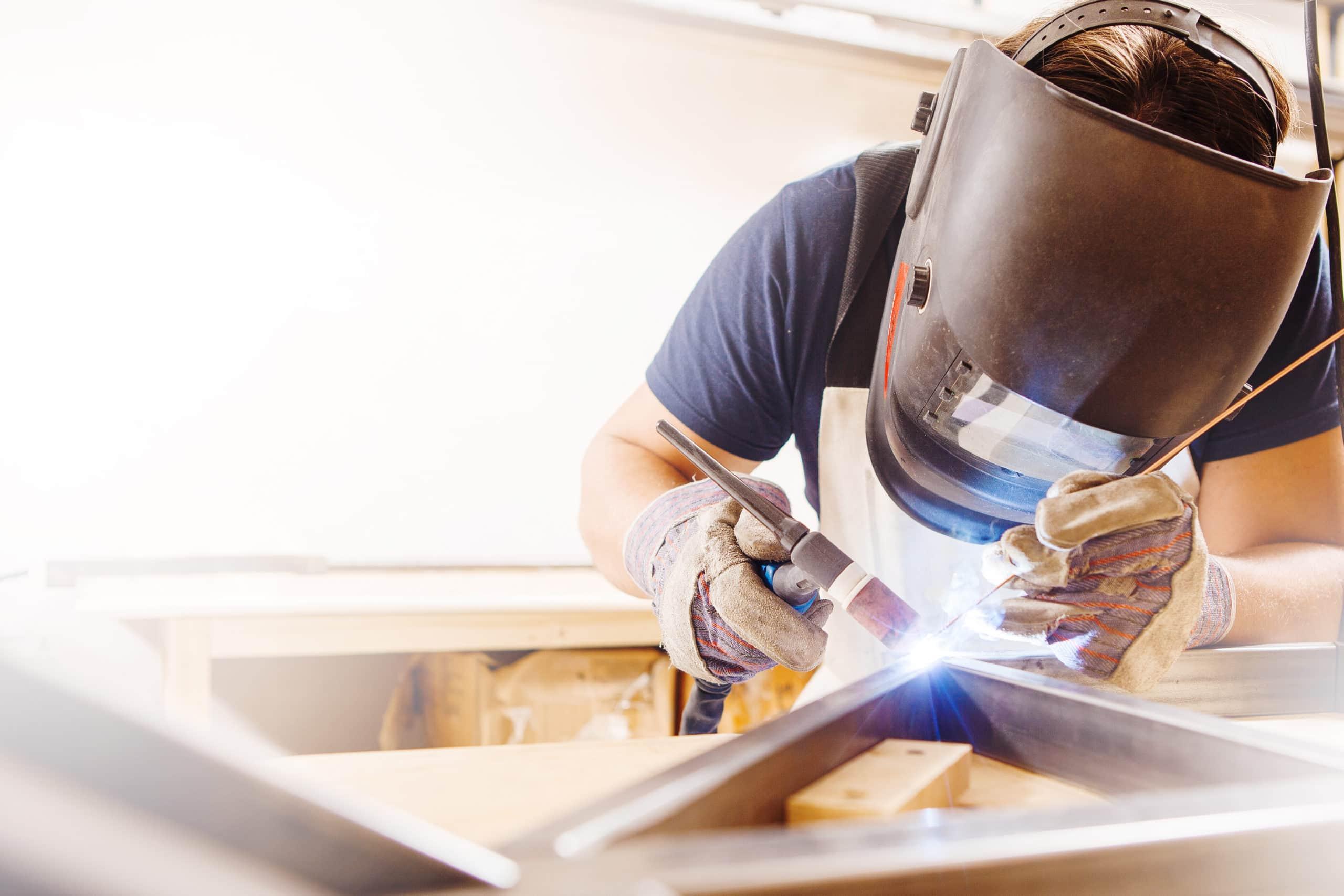 Welder working on steel beams