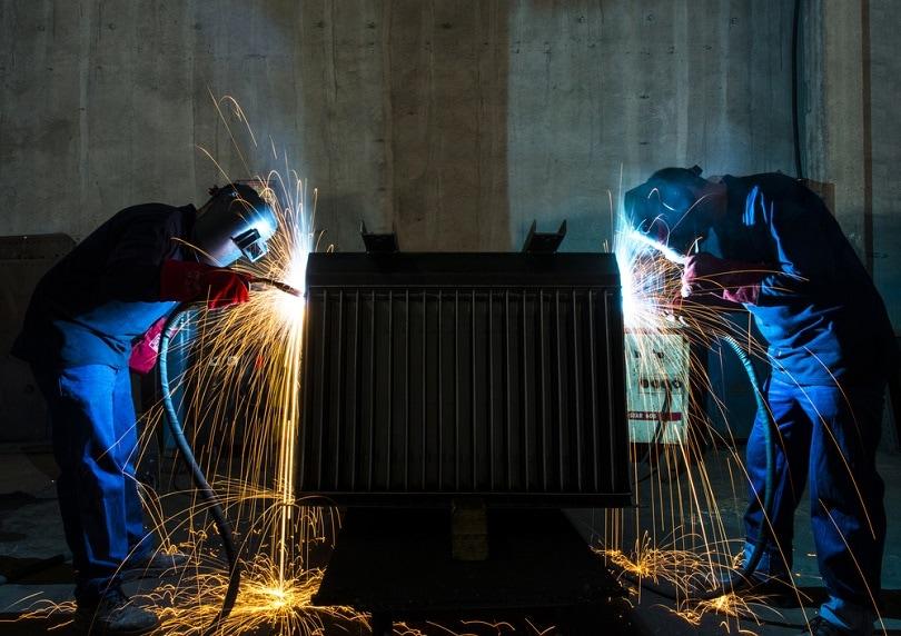 Two,Workers,Welding,Transformer,In,Factory