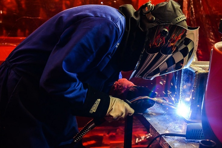 welder with awesome helmet