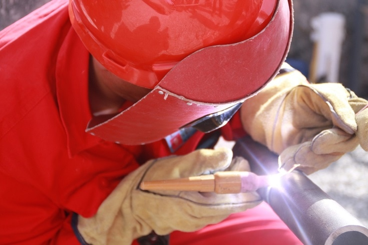 worker wearing red colored protective gears