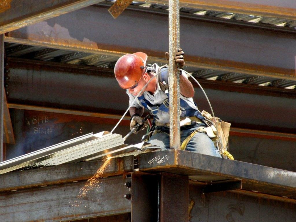 man welding in a building