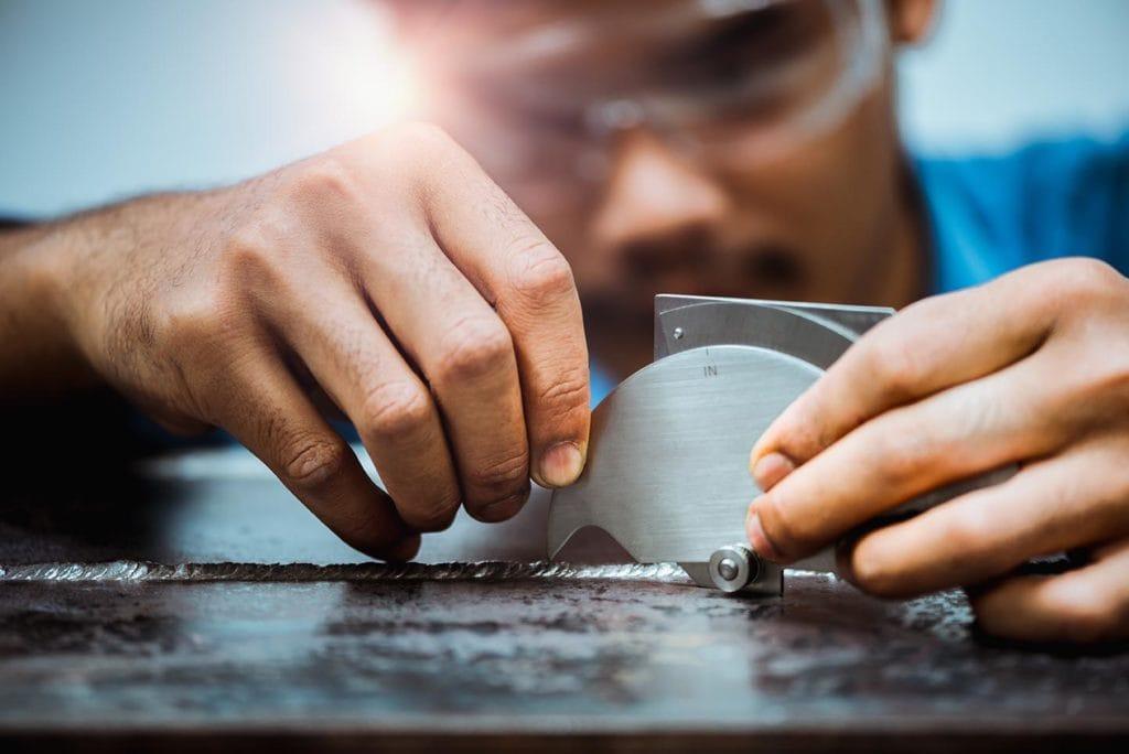 welding inspector using welding gauge