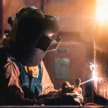 man doing stick welding